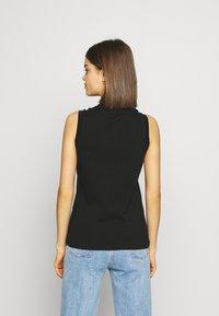 Lacoste - SLEEVELESS BASIC SLIM FIT - Poloshirt - black - 2