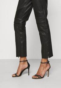 Belstaff - FREYA TROUSER - Leather trousers - black - 4