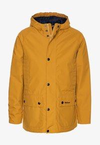 Barbour - BOYS SOUTHWAY - Waterproof jacket - lunar yellow - 0