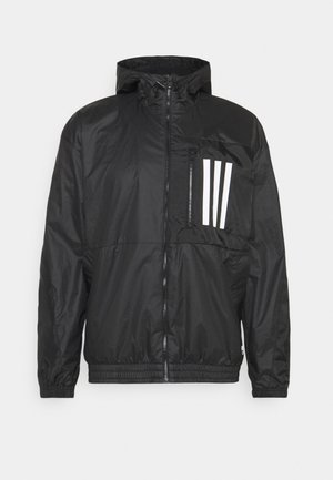 TERRITORY SUSTAINABILITY WIND.RDY RELAXED - Training jacket - black