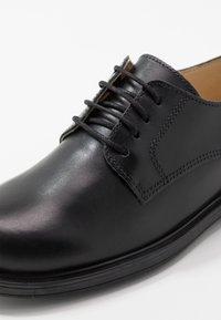 Melania - Šněrovací boty - black - 2