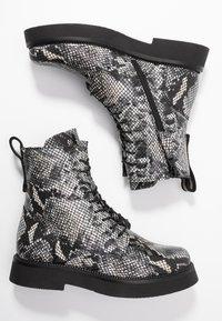 MJUS - Kotníkové boty na platformě - nero - 3