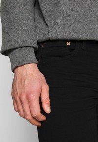 American Eagle - CLEAN - Jeans Skinny Fit - black - 5