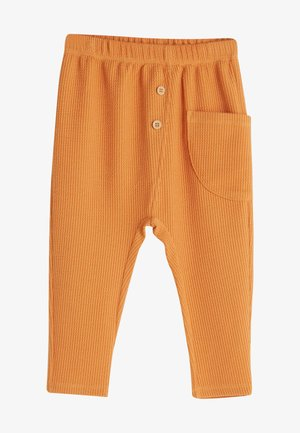 DOTTY FIT - Tracksuit bottoms - orange