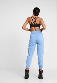NEW girl ORDER - WHAT'S YOUR SIGN JOGGERS - Pantalon classique - blue - 2