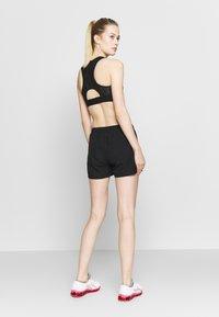 ASICS - SHORT - Sports shorts - performance black - 2