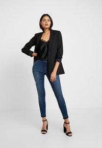 Spanx - DISTRESSED - Jeans Skinny Fit - medium wash - 1