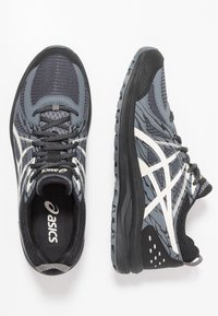 ASICS - FREQUENT TRAIL - Trail running shoes - black/birch - 0