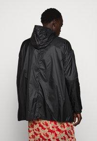 PYRENEX - WATER REPELLENT AND WINDPROOF - Waterproof jacket - black - 2