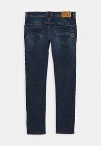 Diesel - THOMMER-J PANTALONI - Jeans Skinny Fit - blue denim - 1