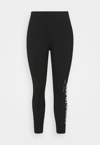 PLUS VERTICAL LOGO - Leggings - Trousers - black