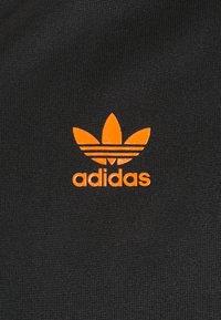adidas Originals - SWAROVSKI TRACK UNISEX - Sportovní bunda - black/trace orange - 5