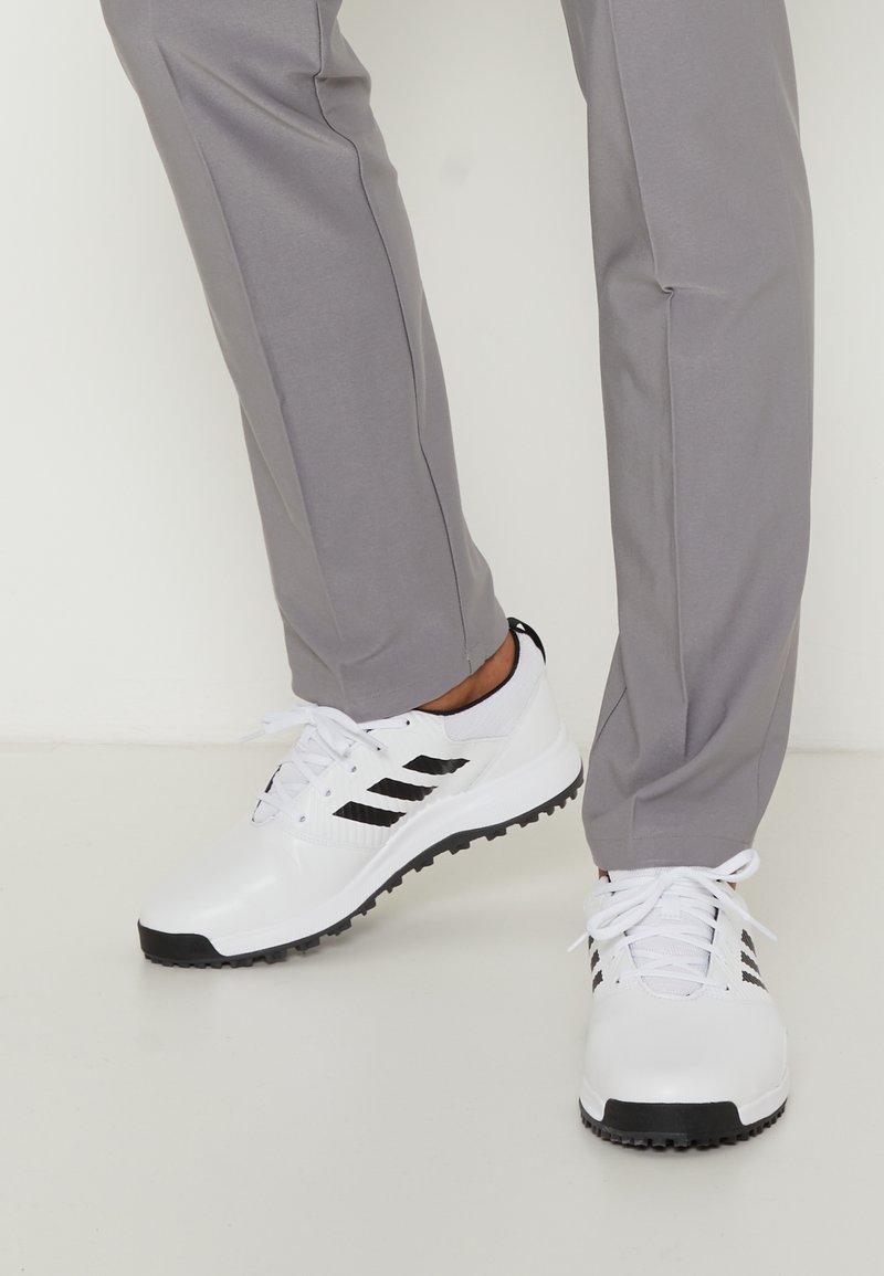 adidas Golf - TRAXION - Golf shoes - footwear white/core black/grey six