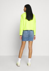 ONLY - ONLBLUSH RAW - Denim skirt - light blue denim