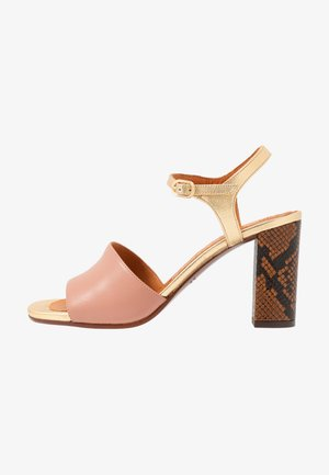 High heeled sandals - nude/oro