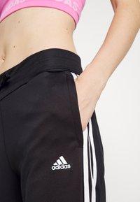 adidas Performance - Tracksuit bottoms - black/white - 6