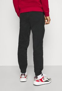 Champion - ROCHESTER ACID WASH PANT - Tracksuit bottoms - black - 2