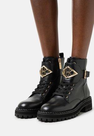 BIKER - Platform ankle boots - black