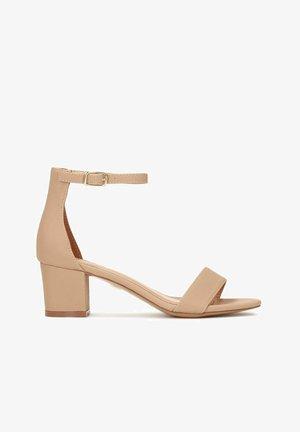 MAKIRA - Ankle cuff sandals - beige