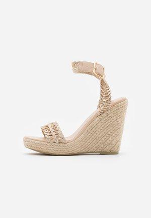 High heeled sandals - natural