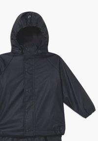 CeLaVi - RAINWEAR SET UNISEX - Pantalones impermeables - navy - 5