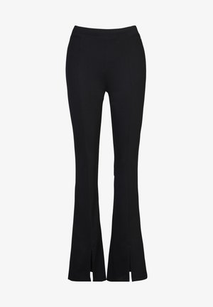 CAROLA - Trousers - black