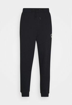 URBAN PANTS - Tracksuit bottoms - black