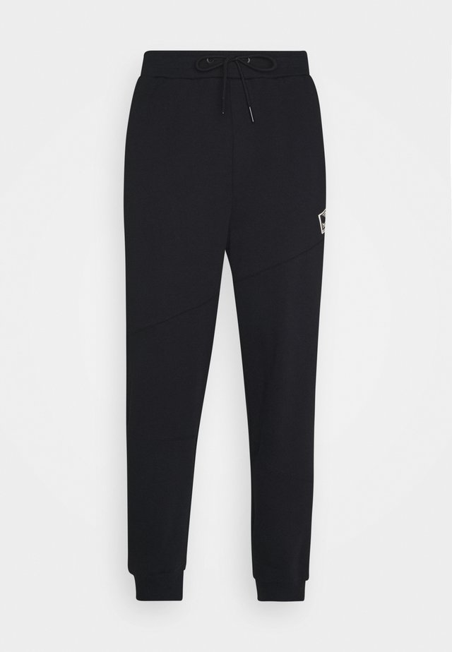 URBAN PANTS - Tracksuit bottoms - black