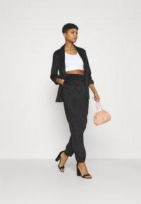 NA-KD - NARROW HEM TROUSERS - Trousers - black - 1