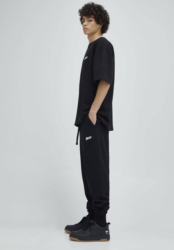 PULL&BEAR Spodnie treningowe - mottled black/czarny melanż Odzież Męska MUAR