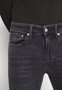 Calvin Klein Jeans - SKINNY - Skinny džíny - black - 5
