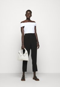 Theory - SLIT PULL ON ADMIR - Trousers - black - 1