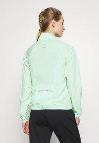 ONLY Play - ONPPERFORMANCE RUN JACKET - Sports jacket - green ash/black - 2