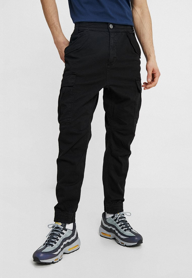 Alpha Industries - AIRMAN - Cargo trousers - black