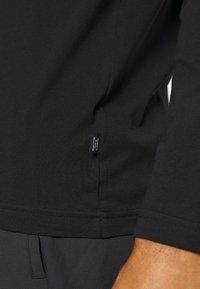Puma - AMPLIFIED TEE - Long sleeved top - black - 5