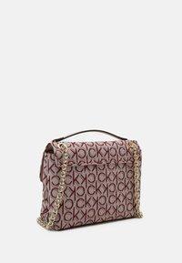 Calvin Klein - RE LOCK CROSSBODY - Across body bag - pink - 5