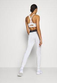 Champion - CUFF PANTS LEGACY - Tracksuit bottoms - white - 2