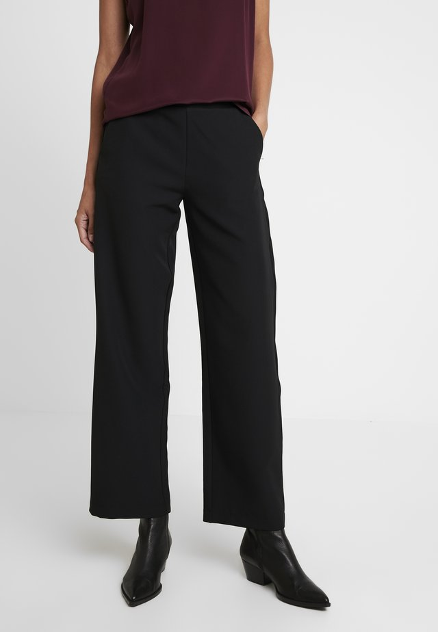 DUNA PANTS - Trousers - black