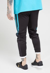 SIKSILK - FITTED TAPE TRACK PANTS - Tracksuit bottoms - black/teal - 2