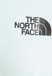 The North Face - INTERNATIONAL WOMENS DAY TEE - Print T-shirt - misty jade - 2