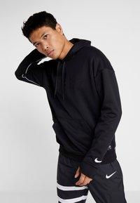 Nike Performance - FC HOODIE - Hoodie - black/white - 0