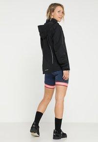 Vaude - WOMENS ESCAPE BIKE LIGHT JACKET - Waterproof jacket - black - 2