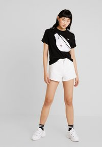 Fila - ADALMIINA TEE - Print T-shirt - black - 1