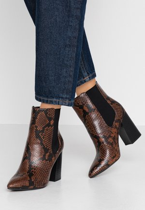 HIGHRISE - High heeled ankle boots - rust