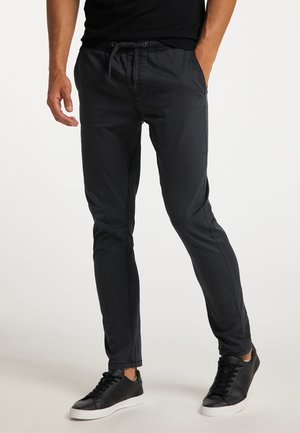Pantalon de survêtement - schwarz