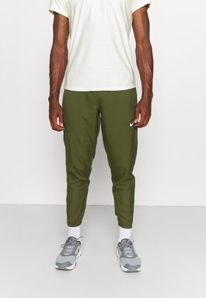 PANT - Tracksuit bottoms - rough green
