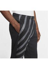 Nike Sportswear - SUBSET - Træningsbukser - black - 4