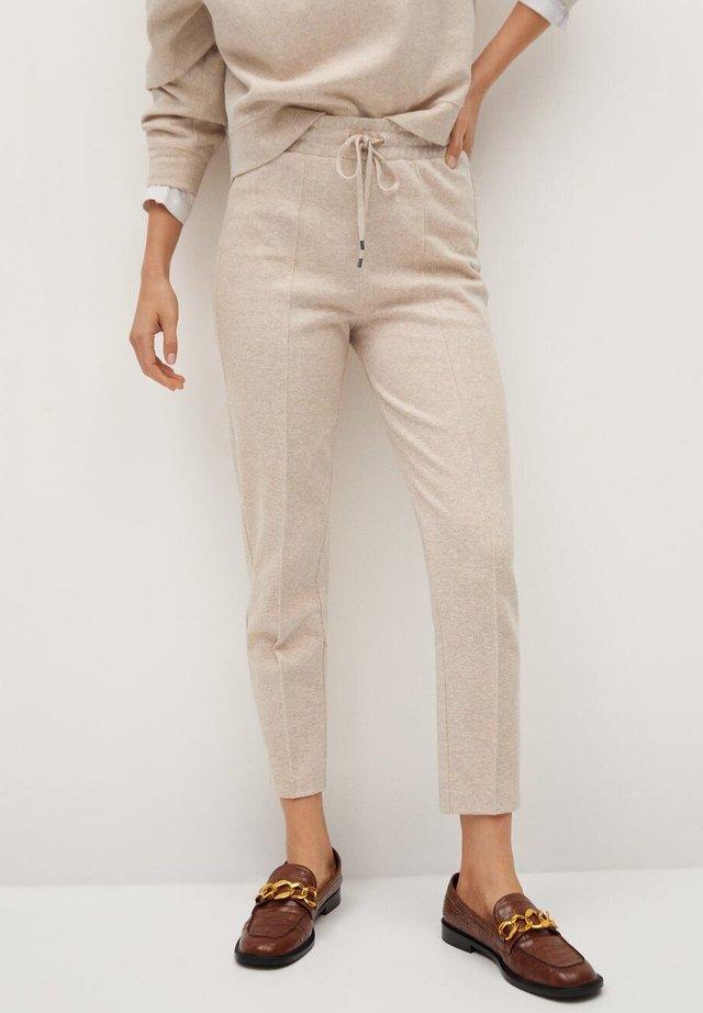 PIQUE7 - Pantalon de survêtement - písková
