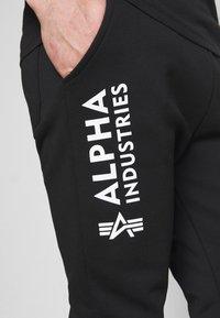 Alpha Industries - BASIC - Tracksuit bottoms - black - 3
