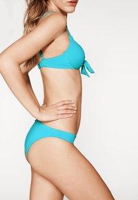 Calzedonia - PATRIZIA INDONESIA - Bikini top - blue - 3